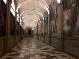 A room lined with paintings of famous Biblical scenes